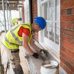 Bryanston Court II, W1H workman repairing window frame